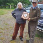 Chair presenting the new Senior Trophy to Jim Braithwaite
